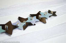 Close up of handmade star sequins Astrid bridesmaid belt