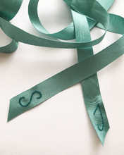 An example of Stephanie Jacqueline Bridal hand monogramming and coloured ribbon
