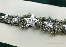 close up of silver star hand beading on bibha bridal belt