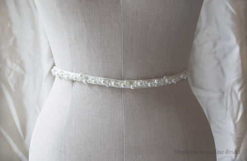 Hand embellished pearl belt shown on mannequin