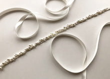 Flat lay image of delicate pearl bridal belt