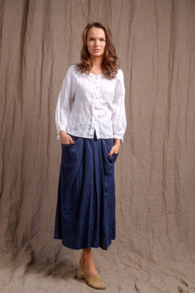 long sleeve linen top with front buttons and long navy skirt with pockets