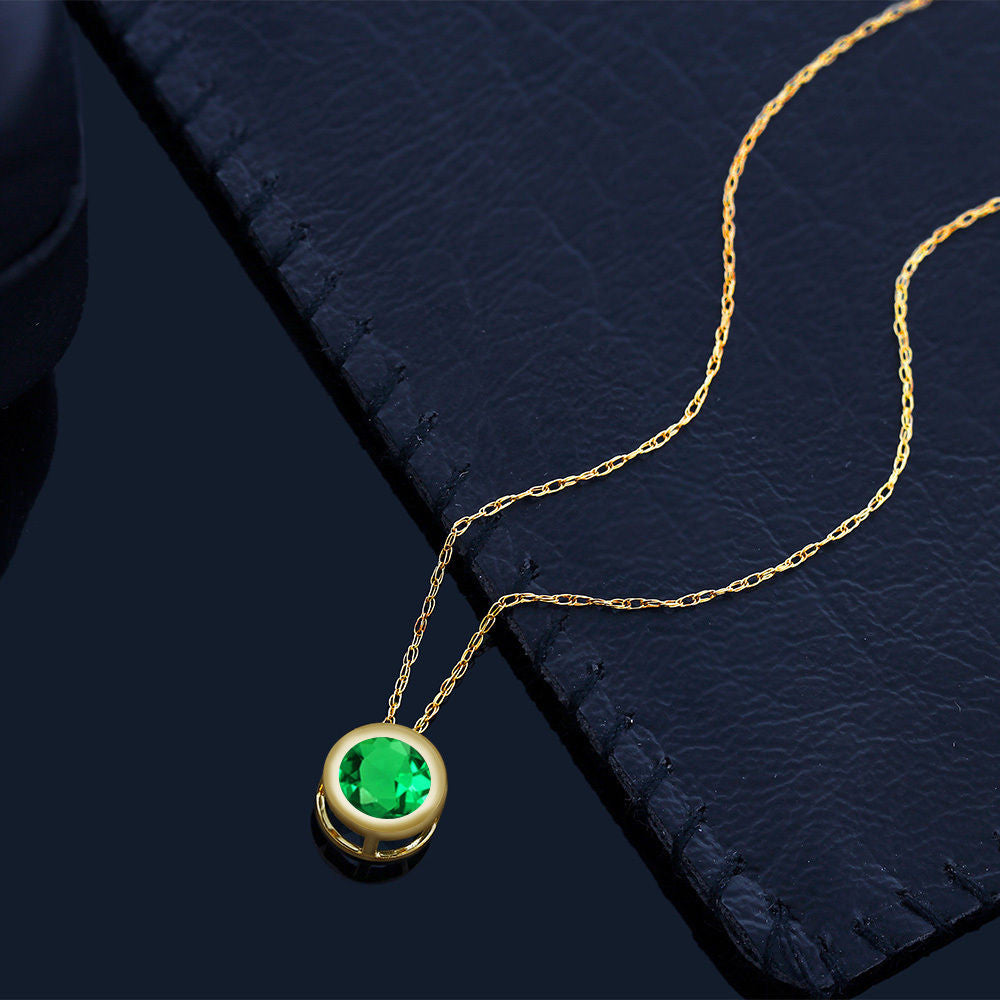 077 ct round green simulated emerald 14k yellow gold pendant with 077 ct round green simulated emerald 14k yellow gold pendant with chain aloadofball Image collections