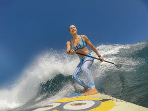 Woman SUP surfing