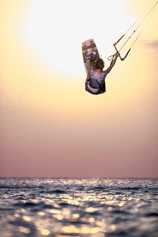 Woman jump kiteboarding