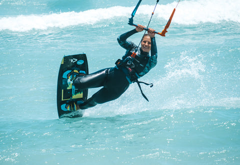 Woman kiteboarding slide
