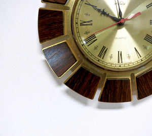 MID CENTURY TEAK AND BRASS TIMECAL WALL CLOCK