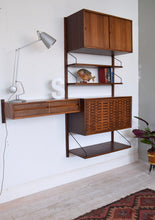 Danish Rosewood Wall Shelving System By Poul Cadovius