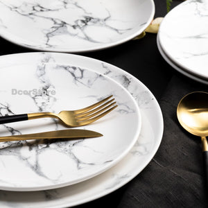 marble plates with gold flatware