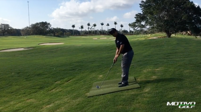 Adjustments When Striking On A Downhill Lie