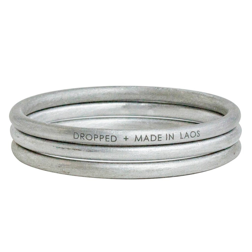 Dropped + made in Laos Peacebomb silver metal bangle bracelet