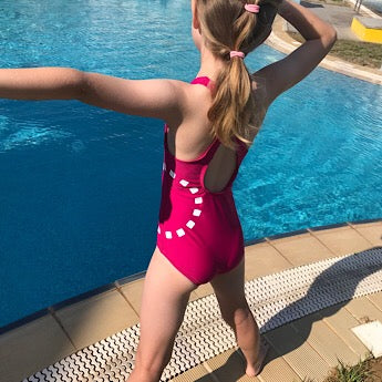 Magenta cross-back swimming costume