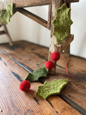 "Holly and Berry Wool Felt Christmas Garland. This adorable garland is perfect for your tree, strung across your mantel, or bordering a table with other Christmas displays. Wool Felt Green and Red with Gold stitching 59"" long. Holiday home decor and home styling services by At the Farmhouse."