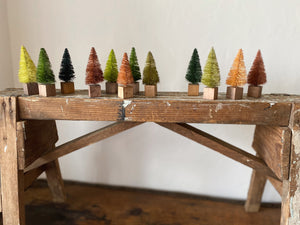 "Give your home some Christmas cheer with these adorable mini bristle trees! Set of 12 multicolored 3"" tall trees Holiday home decor and home styling services by At the Farmhouse."
