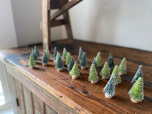 "Give your home some Christmas cheer with these adorable mini bristle trees! Give your home some holiday cheer with these adorable mini bristle trees! Set of 24, 2"" trees, dark and light green snow covered trees. Holiday home decor and home styling services by At the Farmhouse."