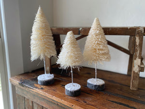 "Give your home some Christmas cheer with these adorable cream bristle trees! 3 sizes available: Small: 5.5"" round x 12"" tall, Medium: 6.25"" round x 14"" tall, Large: 6.25"" round x 16"" tall. Holiday home decor and home styling services by At the Farmhouse."