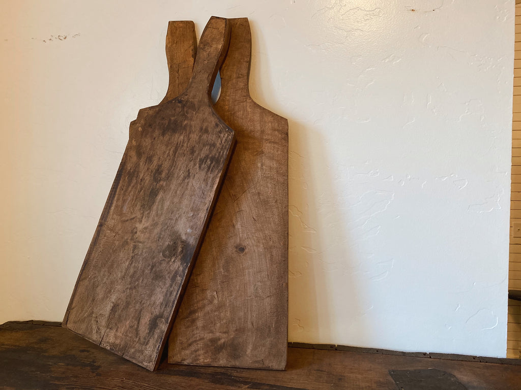 "Paddle Style Cutting Board. Size and coloring will vary slightly, measures approximately 25.5"" long with handle, actual board measures 17.2"" long x 8.25"" wide x .75-1"" thick, use for decoration or use for everyday, perfect for charcuterie. Home decor products and styling services by At the Farmhouse."
