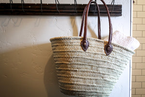 Rolled leather handled market basket. Styling and home decor by At the Farmhouse.