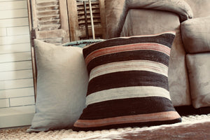 Add some personality to your furniture and a pop of color with this pillow cover recycled from a beautiful Turkish Kilim rug. Home styling and decor by At the Farmhouse.