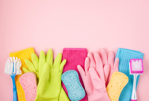 colorful cleaning supplies with pink background
