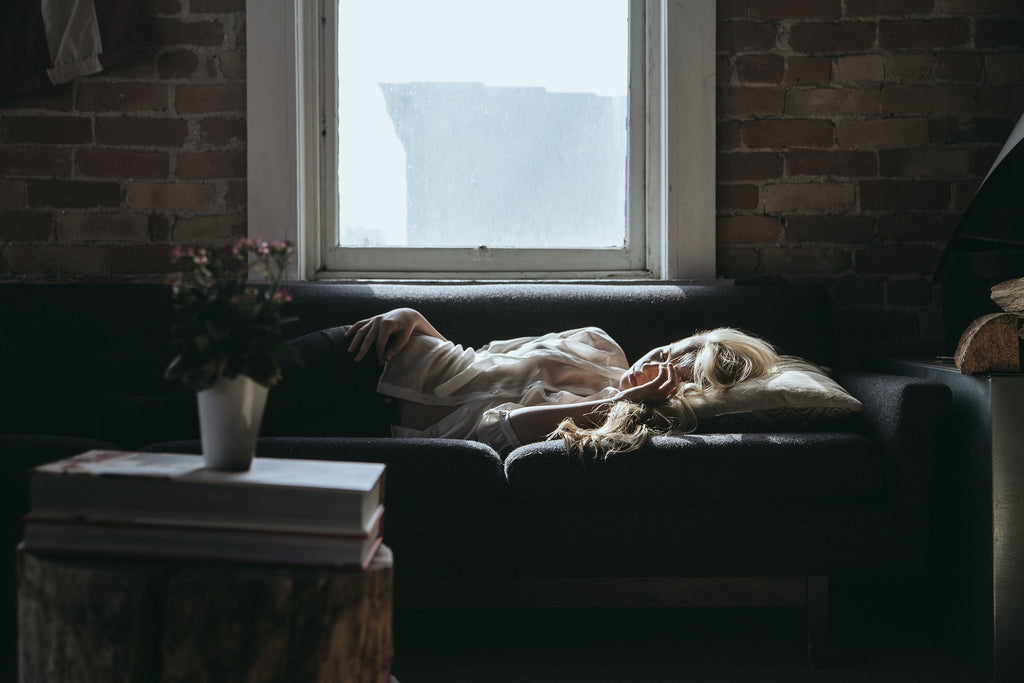 tired woman sleeping on couch