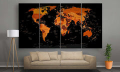 A world map canvas of black with shape orange over continents hanged in the living room | Panelwallart.com