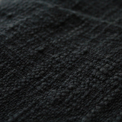 Handwoven black throw in cotton, sustainably made with natural dye