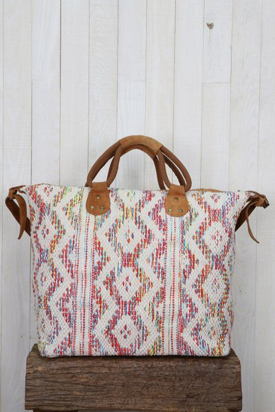Diamond and stripe pattern cross body, weekender bag with suede trim and removable strap.