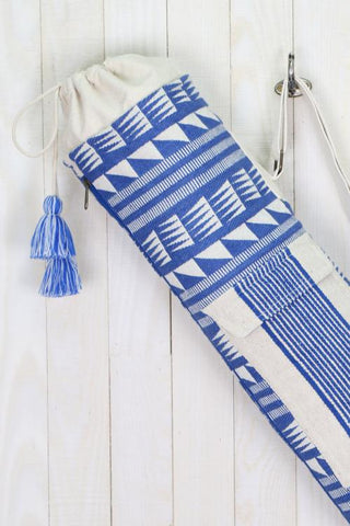 Blue Handwoven, geometrically patterned yoga bag with tassel drawstring closures.  FABRIC 95% ACRYLIC/ 5% COTTON