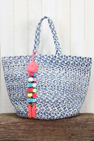 "Multi colored twill yarn bucket bag with tropical colored pom pom and tassel trim. *DIMENSIONS 18""X12""  100% COTTON"