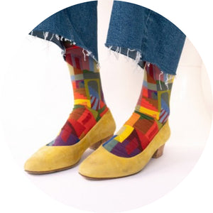 frayed jeans with multi coloured Bonne Maison socks in yellow socks