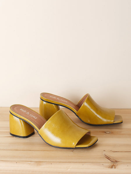 Patent Leather Mules in Gold