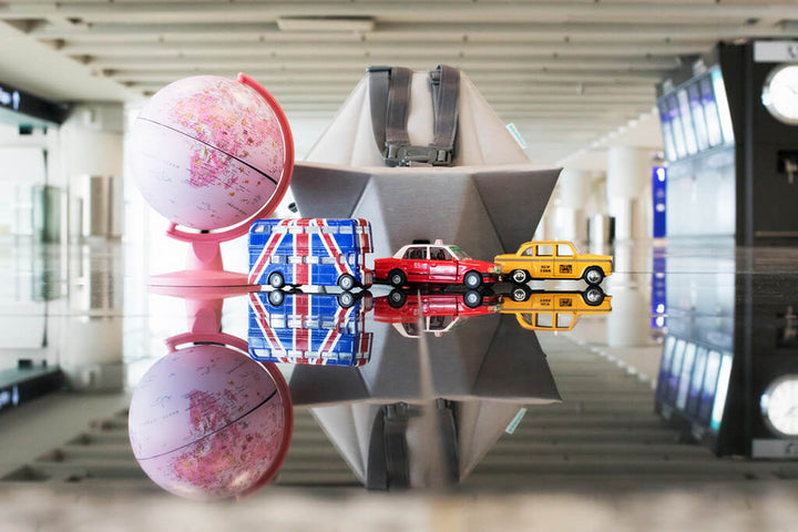 Bombol Pop-Up Booster with toy cars and globe in airport