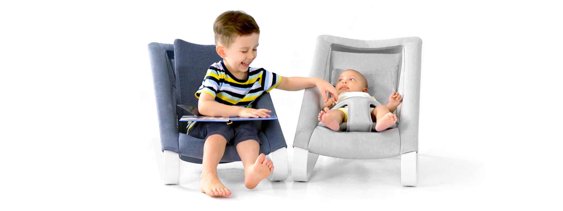 Two little boys on their infant bouncer seat