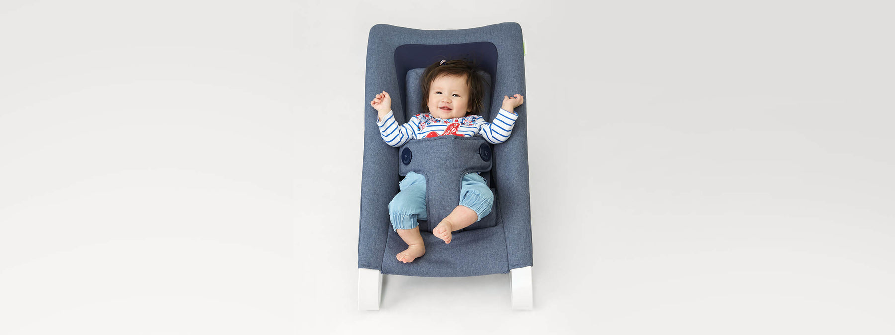 Baby Bouncer Blue Denim with baby relaxin on it