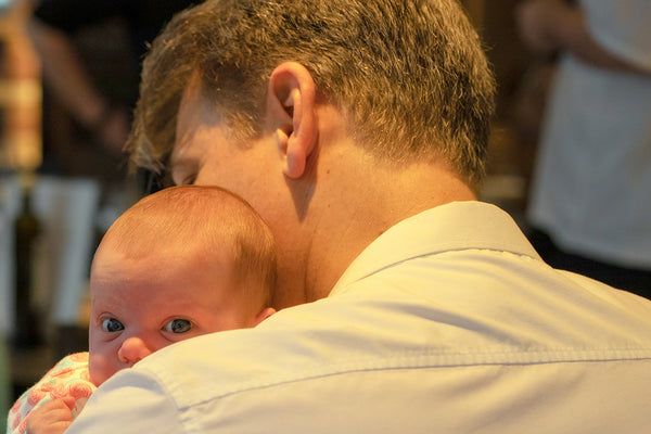 Father with Baby in his arms