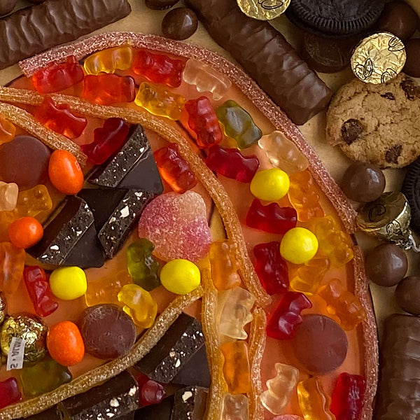 Colorful Candies and Chocolates arranged in a tray