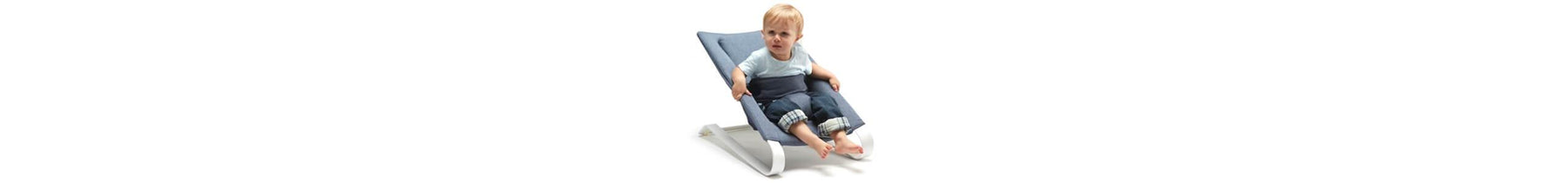 Baby boy seating on a denim blue bombol bamboo bouncer