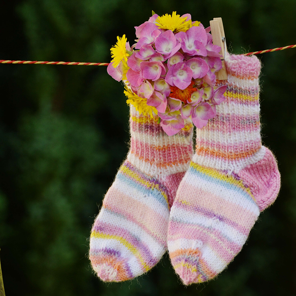 Socks on a wash line with flowers