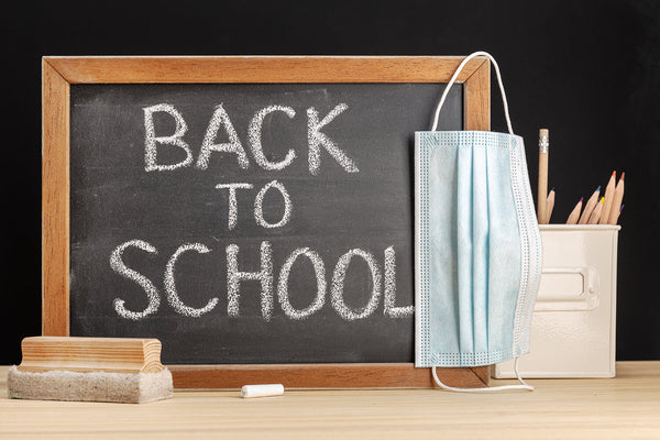Blackboard says Back to School with Mask next to it