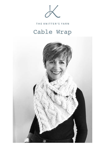 Cable wrap knitted in Puddle available from The Knitter's Yarn
