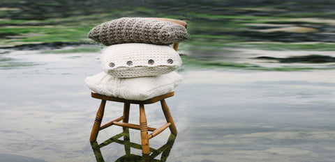 Cushions knitted in Puddle by The Knitter's Yarn