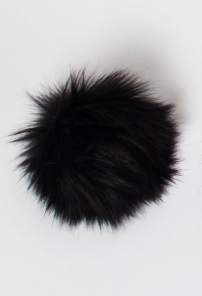 Rowan vegan faux fur pompom in Fox Black available from The Knitter's Yarn.