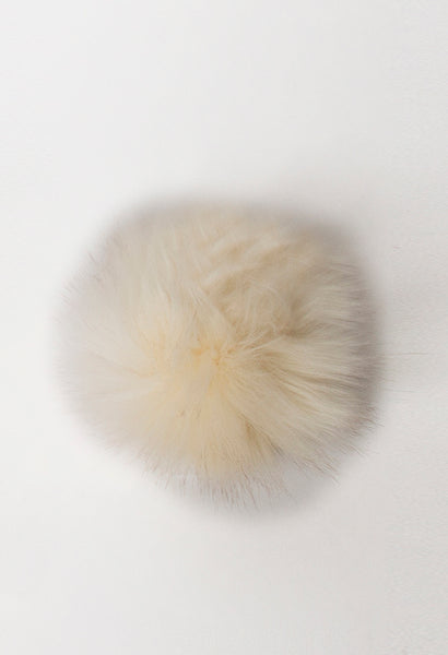 Rowan vegan faux fur pompom in Fox Cream available from The Knitter's Yarn.