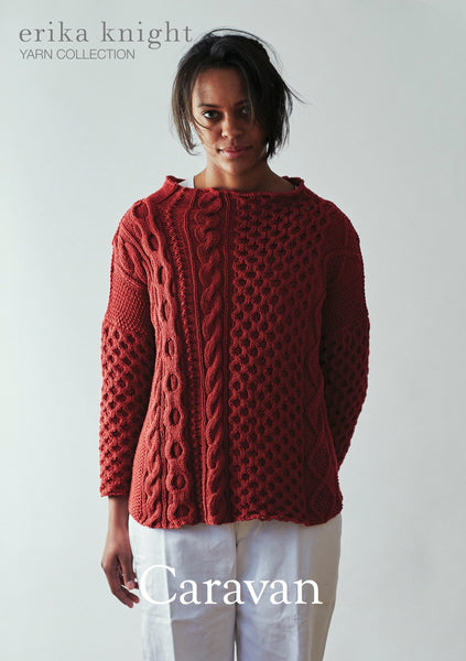 Caravan designed by Erika Knight and knitted in Gossypium Cotton. This aran stitch modern sweater is available in a kit from The Knitter's Yarn.