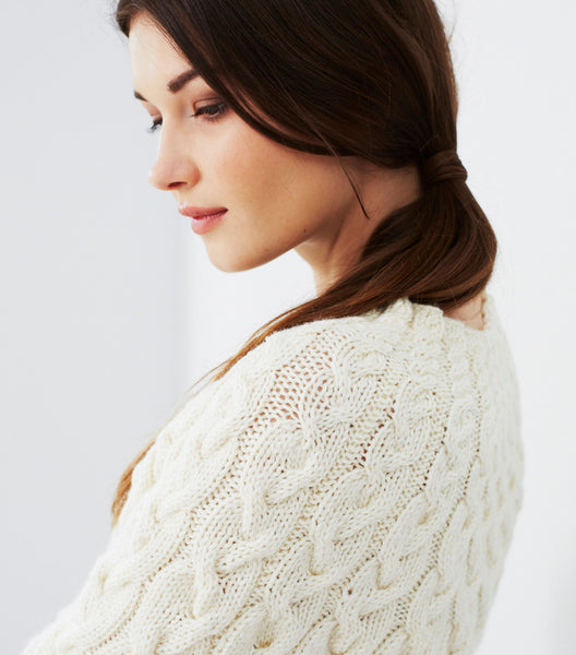 Lovely sweater pattern by Debbie Bliss stocked by The Knitter's Yarn.