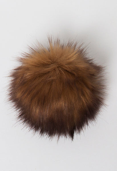 Rowan vegan faux fur pompom in Fox Camel available from The Knitter's Yarn.