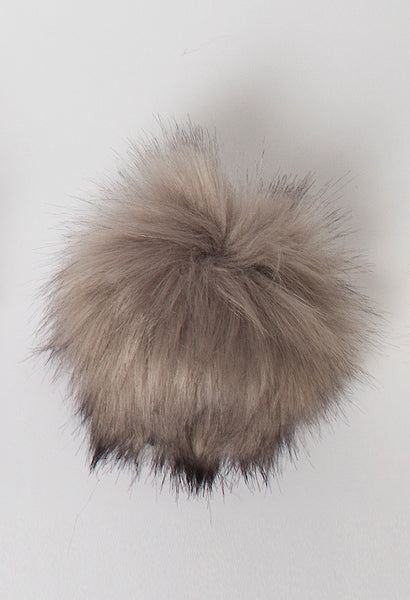 Rowan vegan faux fur pompom in Fox Steel Grey available from The Knitter's Yarn.