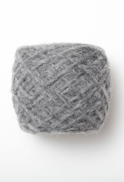 Brushed Fleece by Rowan is a super soft blend of extra fine merino and baby alpaca creating a marl effect. Available at The Knitter's Yarn.