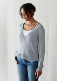 Erika Knight's Porcelain v neck sweater knitted in Studio Linen and available as a kit from The Knitter's Yarn.